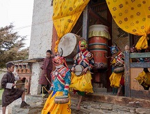 Artistes step out in the monastery courtyard for a dance ritual
