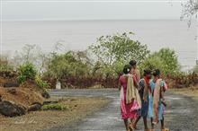 Women on a coastal road in Kokan